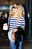 Сиенна Миллер, фото 2850. Sienna Miller arrives at Heathrow Airport - July 31, foto 2850